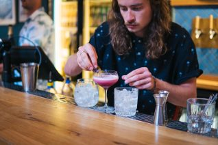 a bartender mixing a yonder cocktail